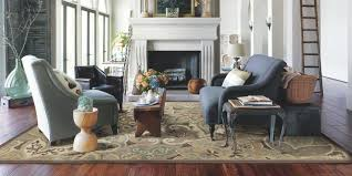 this is a favorite for smaller rooms or smaller sitting areas in larger spaces anchoring the furniture around a small rug defines it without cutting it off