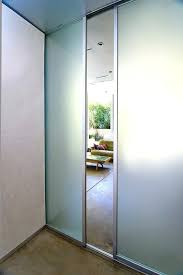 frosted glass pocket doors with sliver frame finish panels