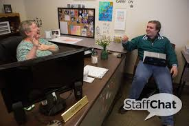 staffchat sue johnston student services office manager brenau sue johnston chats history political science major kyle leineweber in her office