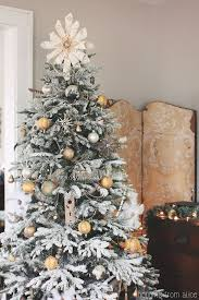 Creative christmas tree toppers ideas try Rustic Beautiful Tree Topper Star Made From Sheet Music Decoist Beautifully Unusual Christmas Tree Topper Ideas
