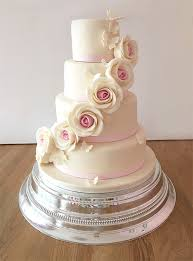 Ivory Wedding Cake With Roses And Butterflies The Cakery