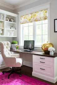 white airy home office. chic home office features a built in desk adorned with bronze pulls accented beveled white airy 2