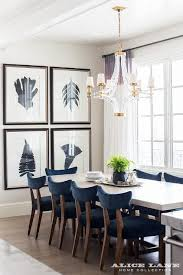 Blue dining room furniture Beach Cottage Accented With Crystal And Brass Chandelier Large Crystal Cube Chandelier Illuminating White Dining Table Lined With Navy Blue Velvet Dining Chairs Decorpad White Wood Dining Table With Blue Velvet Dining Chairs