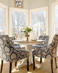 what i want for my kitchen a small round pedestal table with four fy chairs in an easily cleanable sensuede fabric