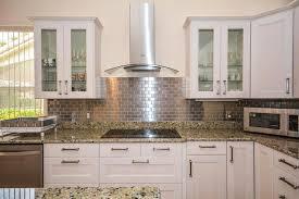 l shaped kitchen with metal mosaic stainless steel brick backsplash