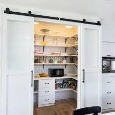 white sliding barn doors. Alluring White Sliding Barn Door Hardware For Hidden Storage With Drawers And Shelves Doors