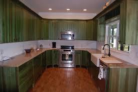 emerald green distressed kitchen