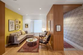 compact living room furniture. Small Livingroom With Wooden Wall, Yellow White Wall Distorted Glass Window, Compact Living Room Furniture
