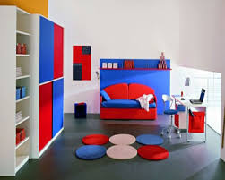 interesting boys bedroom interior ideas with red blue bed along white study desk and chair plus blue kids furniture wall