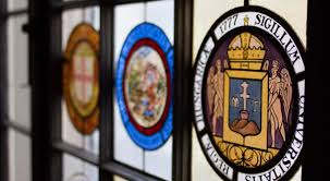 the college room at the university club of denver features collegiate seals in the great windows that line the room