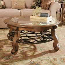 classic small and low round coffee table with glass top