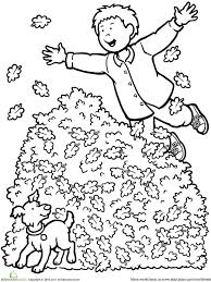 550_color boy jumping leaves printable fall coloring pages on www education com worksheets