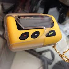 motorola pager. yellow motorola pager in working condition!