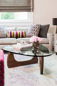 room modern camille glass: a midcentury modern glass coffee table creates the look of more space in this gorgeous sitting