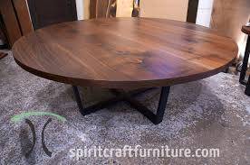 72 inch black walnut round conference table on crossed tzoidal steel base that will seat eight