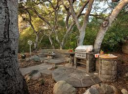 rustic outdoor kitchen patio traditional with bbq pit boulders built in
