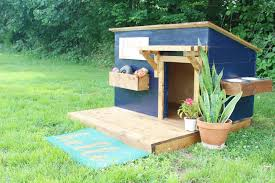 a blue dog house with a deck