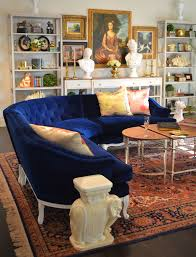 tufted furniture trend. examples of living rooms decorated with blue tufted furniture trend