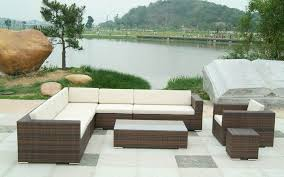 modern design outdoor furniture decorate. charming lake combined with minimalist wicker modern outdoor furniture and big stone decoration natural green tree design decorate n