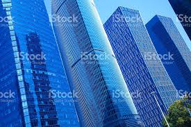 glass exterior modern office. modern office architecture at blue glass exterior wall backgrounds royaltyfree stock photo