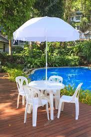 white plastic garden furniture table