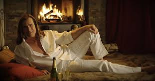 fabio sipping champagne on a bearskin rug is your valentine s day yule log