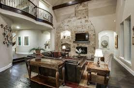 dark wood floors living room. mediterranean sunken living room with leather couch, dark wood floors and fireplace s