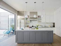 view in gallery kitchen with shaker style cabinets in gray and white