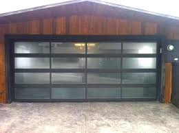 glass panel garage doors glass single garage door modern with black frame and semi translucent panels glass panel garage doors