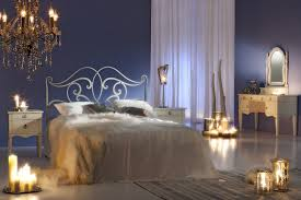 Romantic bedroom design with glass chandelier and candles