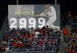 the sign in the center field bleacher seats displays 2 999 for the number of hits