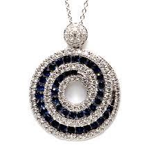 18ct white gold sapphire and diamond swirl pendant