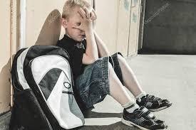 a very sad boy in playground