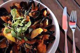 the p e i mussels with white wine noilly prat roasted orange cer tomatoes nicoise