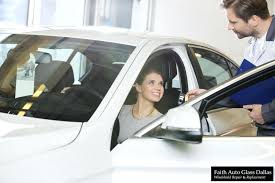 auto glass repair dallas female customer receiving car key from mechanic in automobile ga south