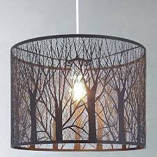 forest tree shadow chandelier casting lamp light bulbs a woodland shade casts shadows forest tree shadow chandelier