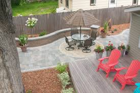 Permeable paver patio pairs perfectly with deck Villa Landscapes