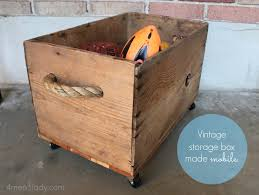 large wooden storage box on wheels