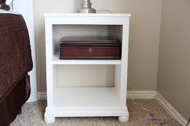 white stained wood bedside table design for bedroom with two shelf and round bedside table legs