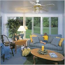 yellow sunroom decorating ideas. Sunroom Decorating Ideas With Elegant Fanceiling Also Comely Blue Sofa Plus Yellow Cushion And Handsome