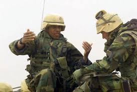 US Marine Corps (USMC) Major (MAJ) Byron Harper (left), S-3 Operations  Officer, and USMC Captain (