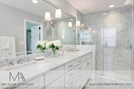 stylish bathroom with white cabinets with white cabinets with white marble countertops contemporary