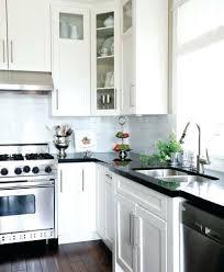 white kitchen black countertops black and white cabinets white kitchen cabinets black granite countertops