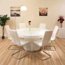 white pedestal dining table for 6 with modern without arm dining chairs on laminate wood floors in contemporary dining room
