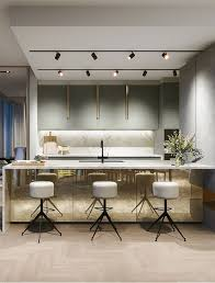 track lights over the kitchen island and a working surface