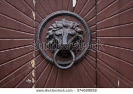 old doorbell with the head of a lion