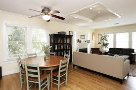 ceiling light with fan above small round table with cozy decorating ideas for small room