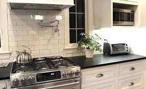 kitchen backsplash with black granite countertops cabinets with subway tile with black granite black kitchen tiles