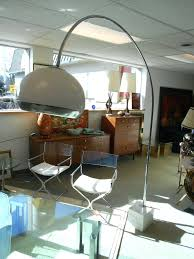 mid century modern lighting ideas mid century modern arc floor lamps above large glass table and two small chairs near wooden chest drawers