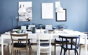 good wall colors for white furniture. a white dining area against blue wall. good wall colors for furniture